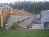 4800 sq.ft. Lock + Load Retaining Wall for the Woodlands patio home strata at the end of Blue Jay Place, Courtenay, BC.